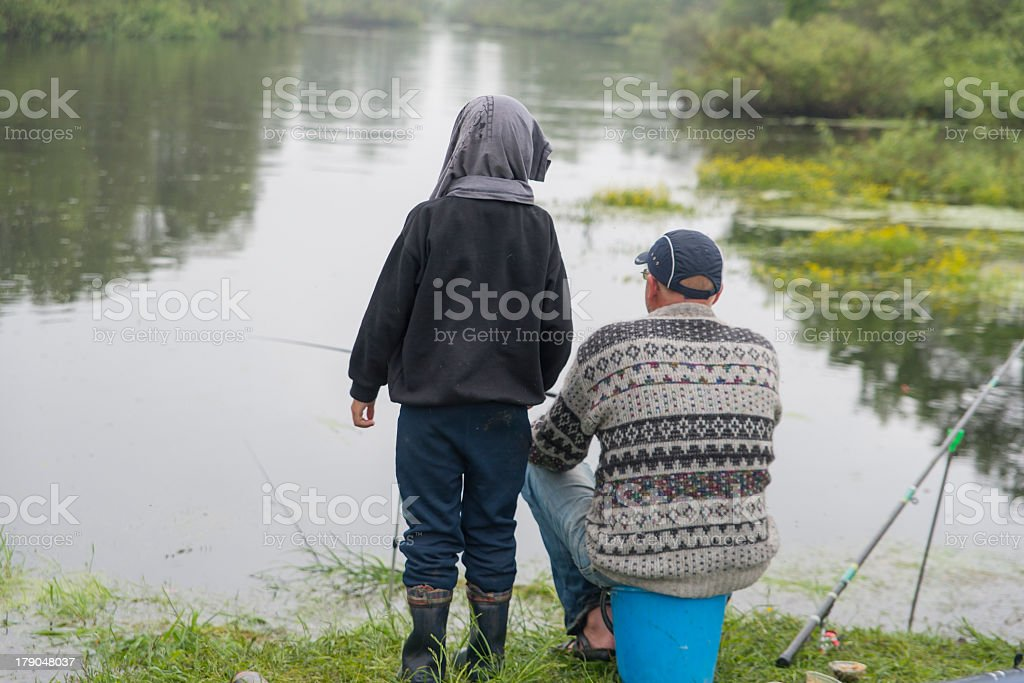 father and the son catch fish stock photo