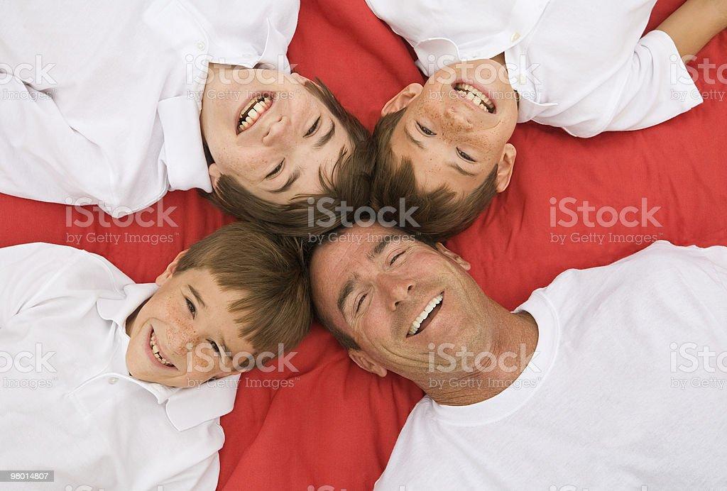 Padre e tre figli foto stock royalty-free