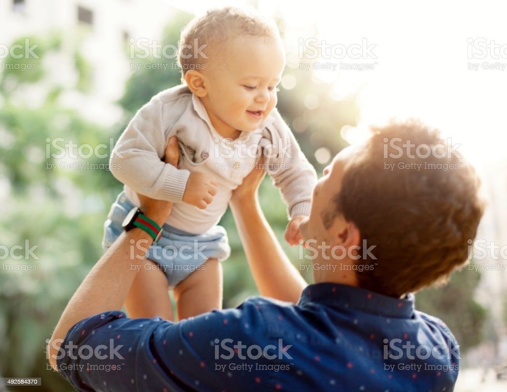 Father and toddler outdoors stock photo