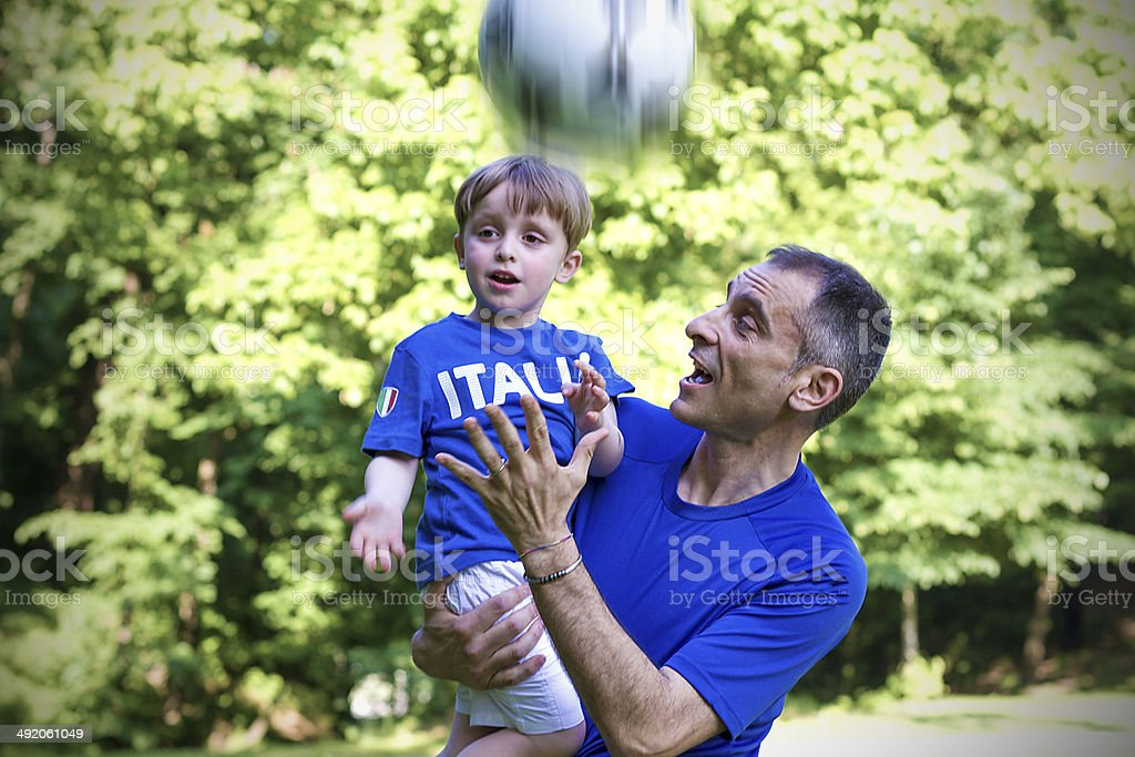Father and  toddler playing with soccer ball royalty-free stock photo