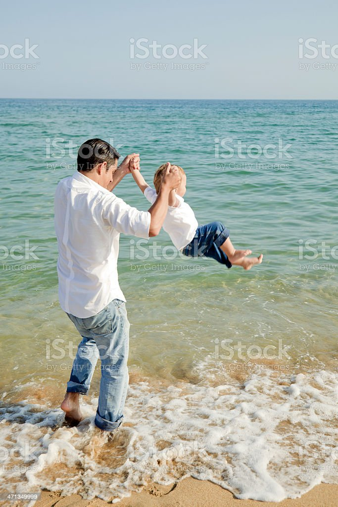 Father and toddler son playing royalty-free stock photo