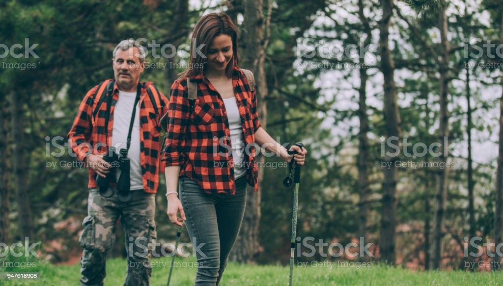 Father and young daughter trail hiking on high mountain stock photo