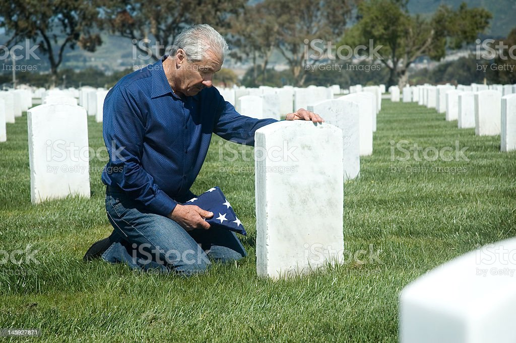 Father at military grave royalty-free stock photo