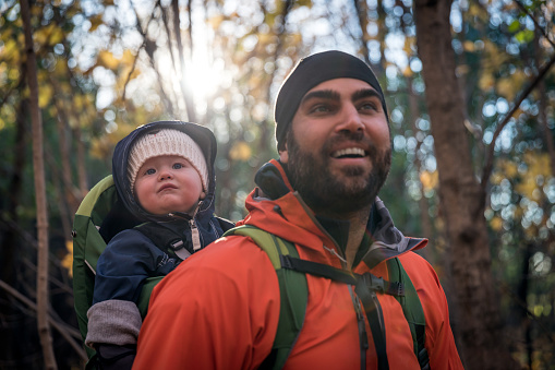 istock Father Backpacking Hiking with Baby in Forest 618456504