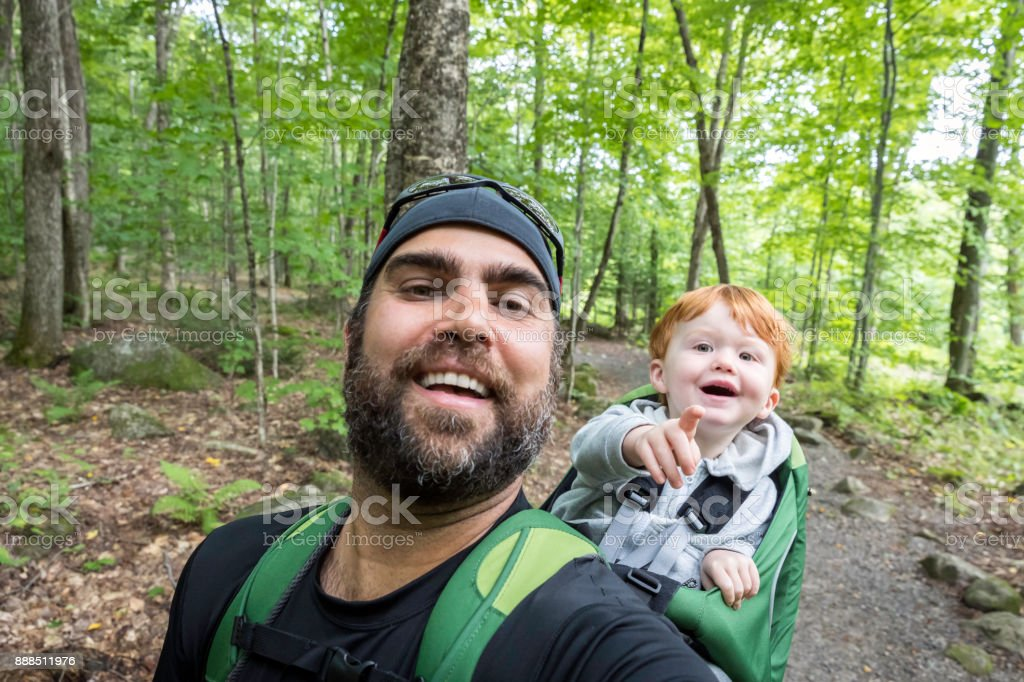 Father Backpacking Hiking with Toddler in Forest stock photo
