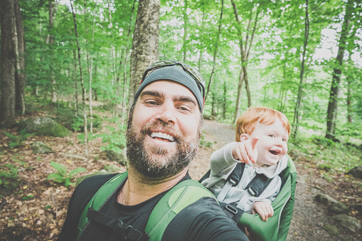 istock Father Backpacking Hiking with Toddler in Forest 888512040