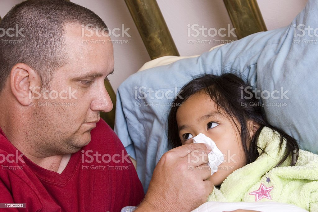 Father caring for sick daughter royalty-free stock photo