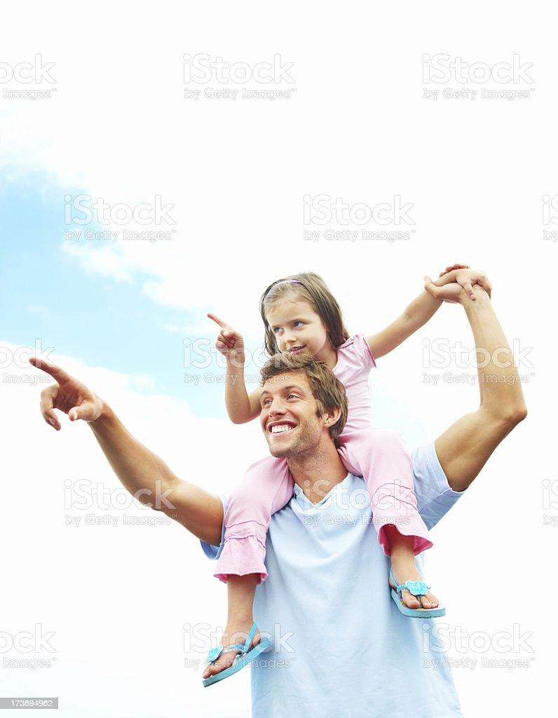 Father carrying daughter on his shoulders royalty-free stock photo