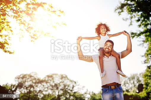 istock Father carrying daughter piggyback 541127976