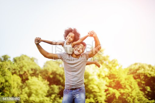 istock Father carrying daughter piggyback 541266460