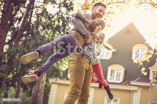 istock Father carrying daughters around neck.  Side view. 866901642