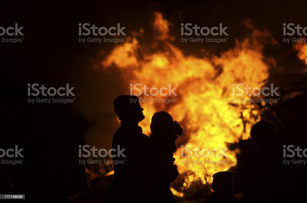 Father carying baby with fire background. stock photo
