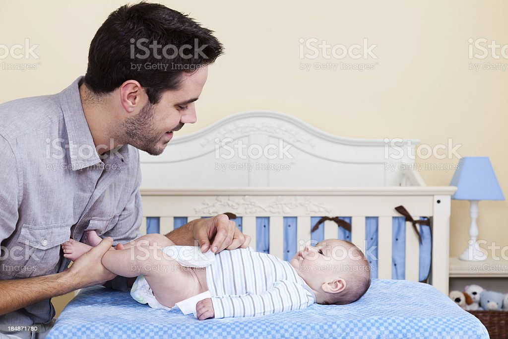 Father Changing Baby Diaper royalty-free stock photo