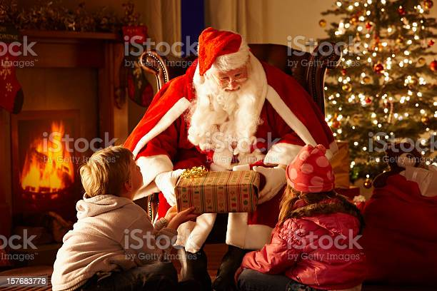 Grottoes Christmas Parade 2021 Father Christmas Giving Gift To Children In Grotto Stock Photo Download Image Now Istock