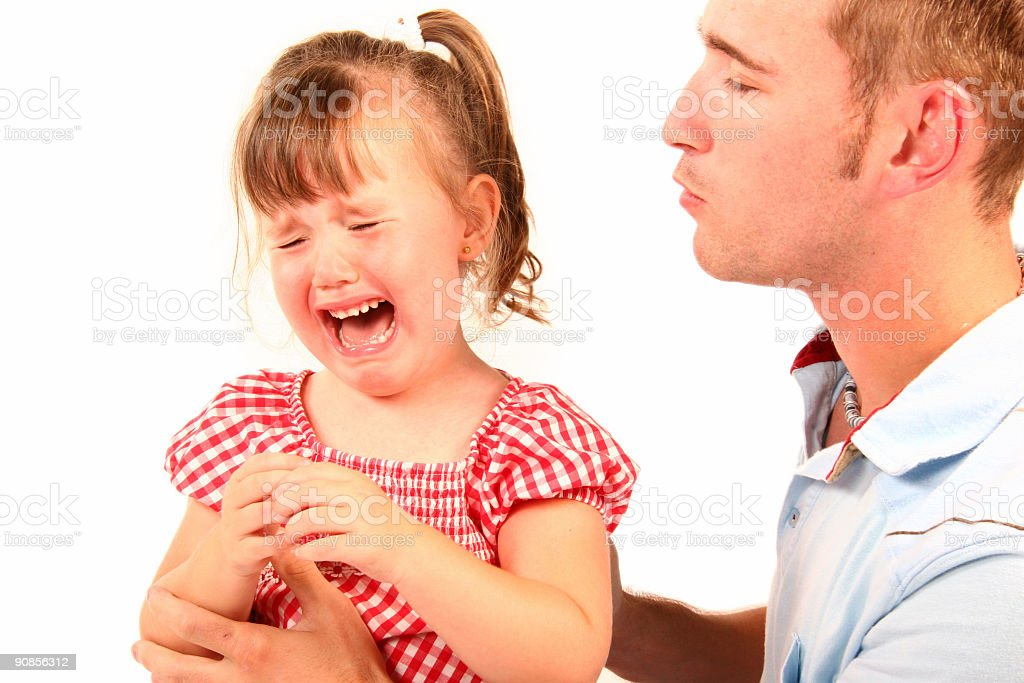 father comfort his daughter crying stock photo