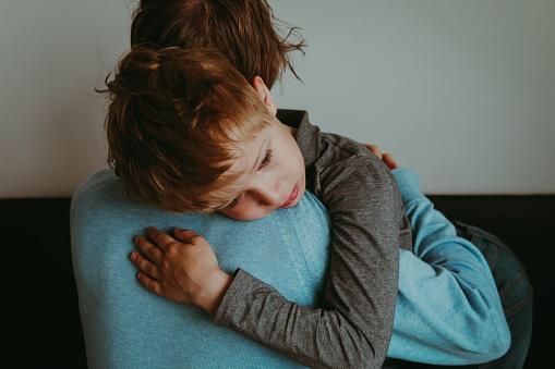 istock Father comforting sad child, parenting, sorrow 954574092