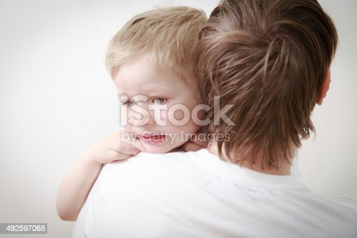 istock father comforting son in tears 492597065