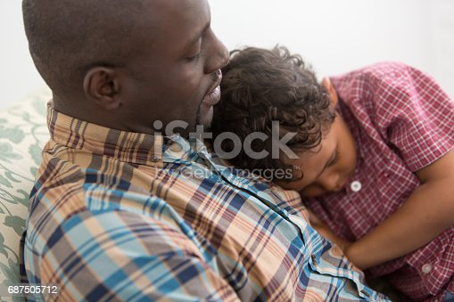 istock Father Comforting Upset Son 687505712