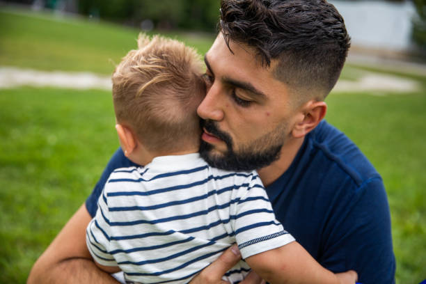 Father Consoling His Toddler stock photo