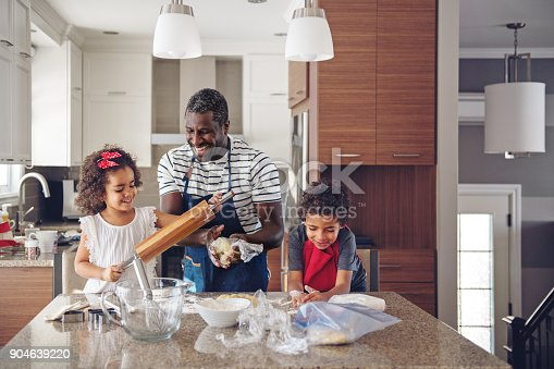 istock Father cooking with kids 904639220