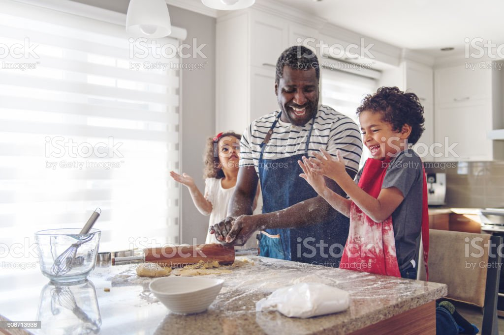 Father cooking with kids stock photo