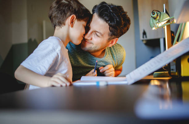 Father cuddle with his son stock photo