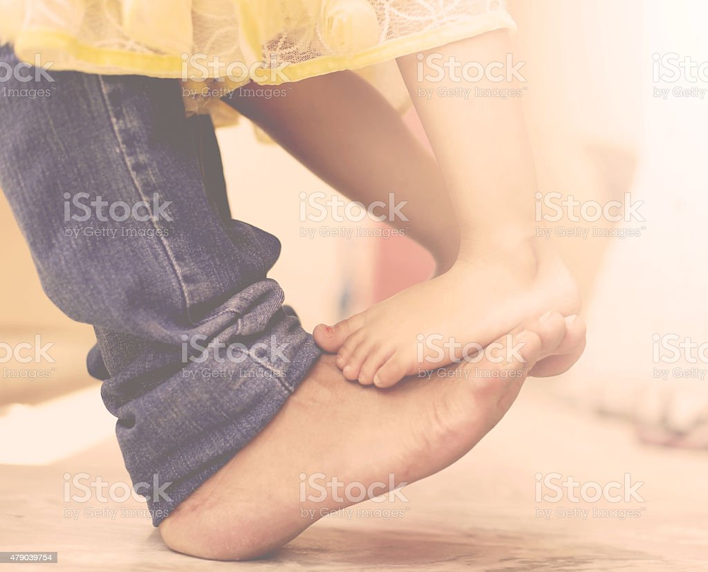 Father dancing with his daughter stock photo