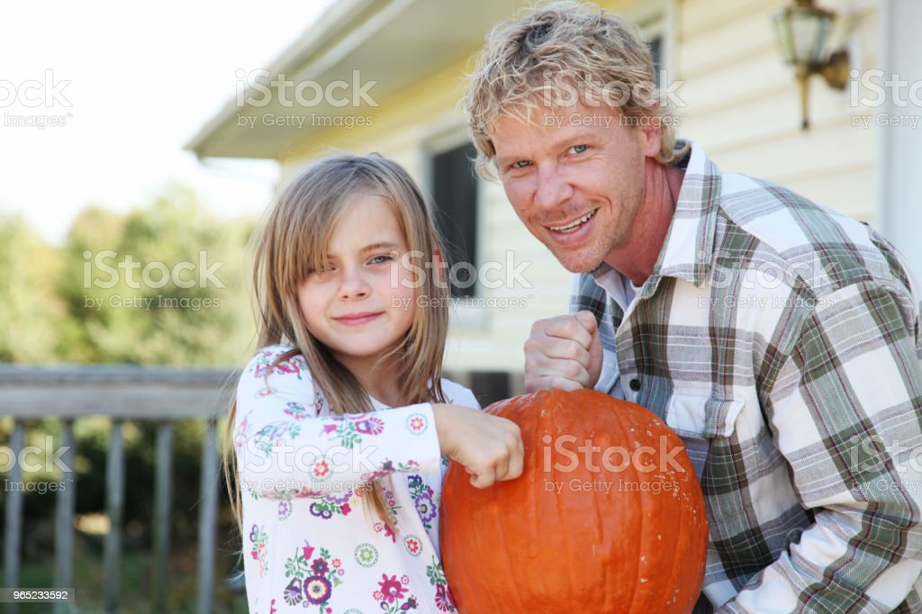 father daughter holding pumpkin royalty-free stock photo