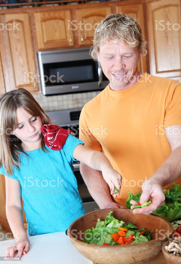 father daughter making salad royalty-free stock photo