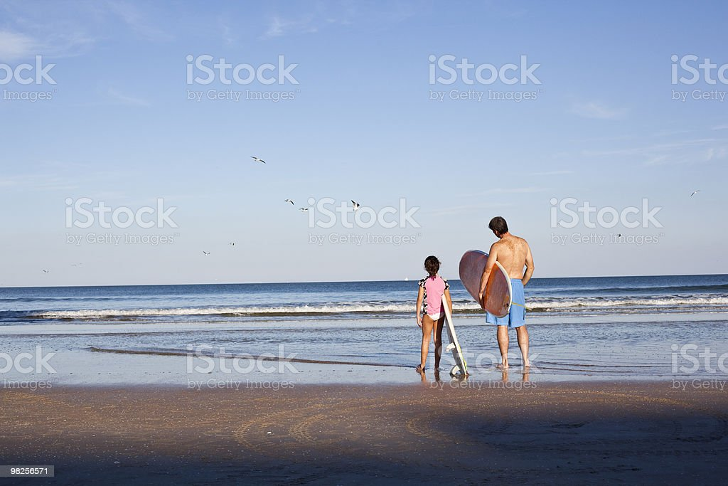 Father Daughter on Surfboard foto stock royalty-free