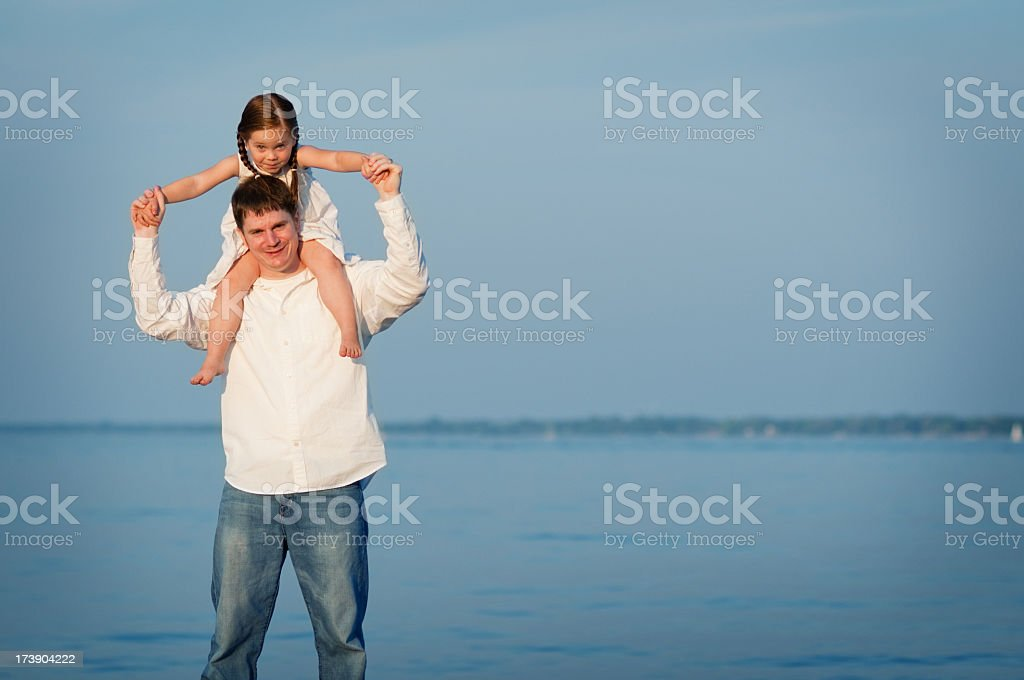 Father & Daughter on the Beach stock photo