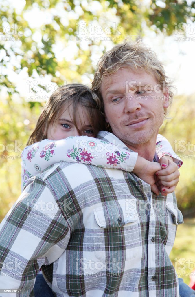 father daughter piggyback ride royalty-free stock photo