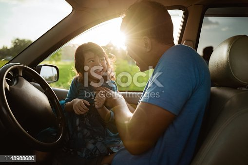 972962180 istock photo father daughter playing in the car together 1148988680