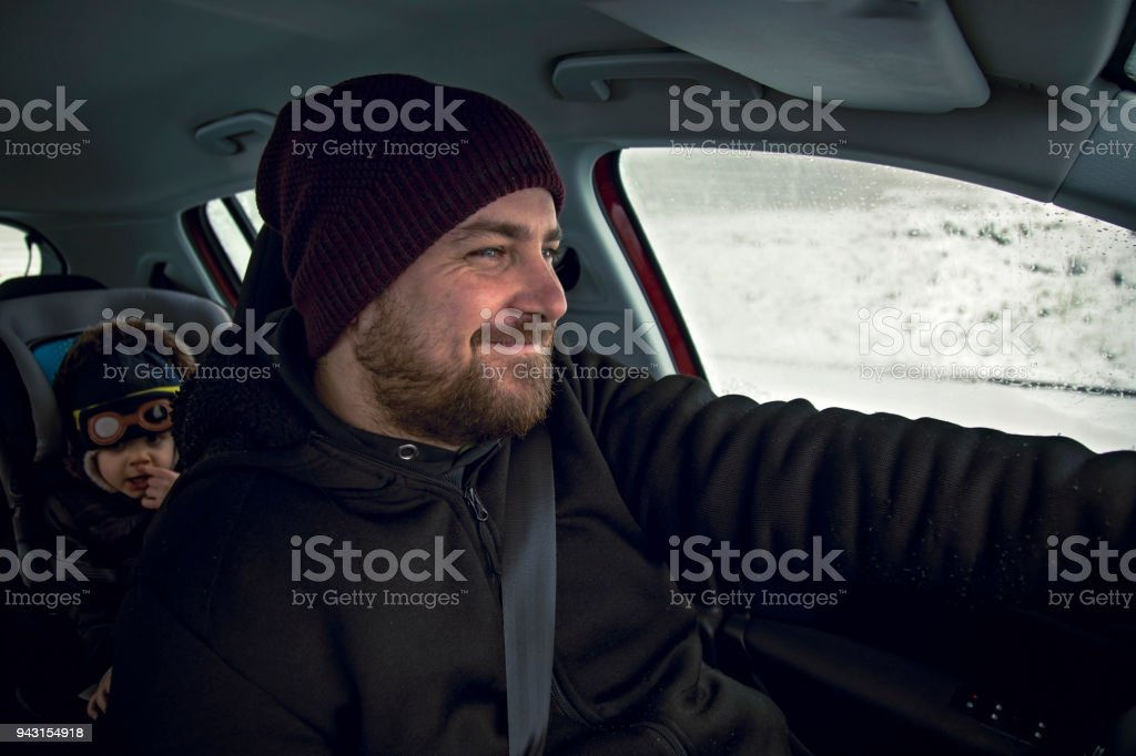 Father driving baby son in the car stock photo