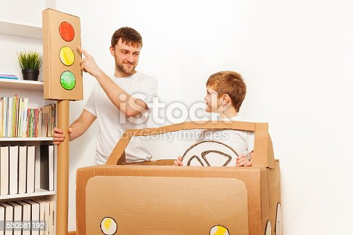 942256562istockphoto Father explaining traffic regulations to his kid 530581192