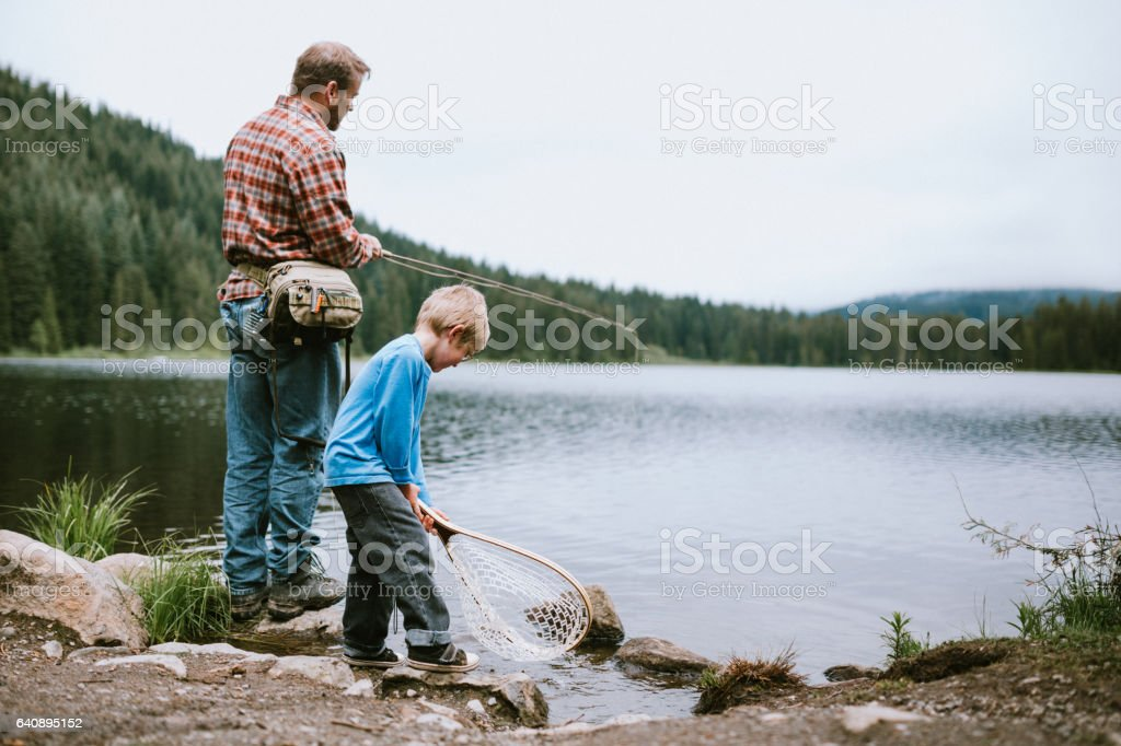 Father Fly Fishing With Son stock photo