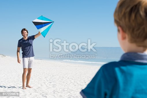 453383283 istock photo Father flying kite 517225878