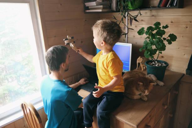 Father freelancer try work from home son child with cat sits and picture id1217954643?b=1&k=6&m=1217954643&s=612x612&w=0&h=bz x2wm9rav839dkspj6qtx5jeynwy2qlwo z0c6fse=
