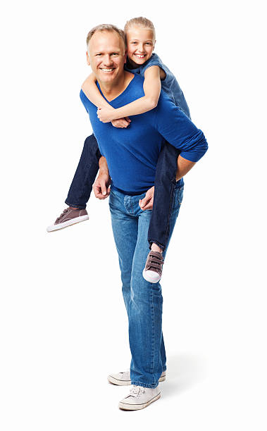 Father Giving His Daughter a Piggyback Ride - Isolated Father carries his daughter playfully on his back. Vertical shot. Isolated on white. piggyback stock pictures, royalty-free photos & images
