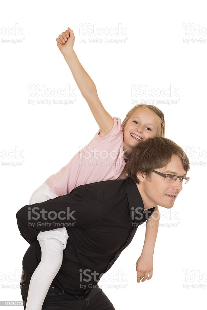 Father giving piggyback ride to his daughter royalty-free stock photo