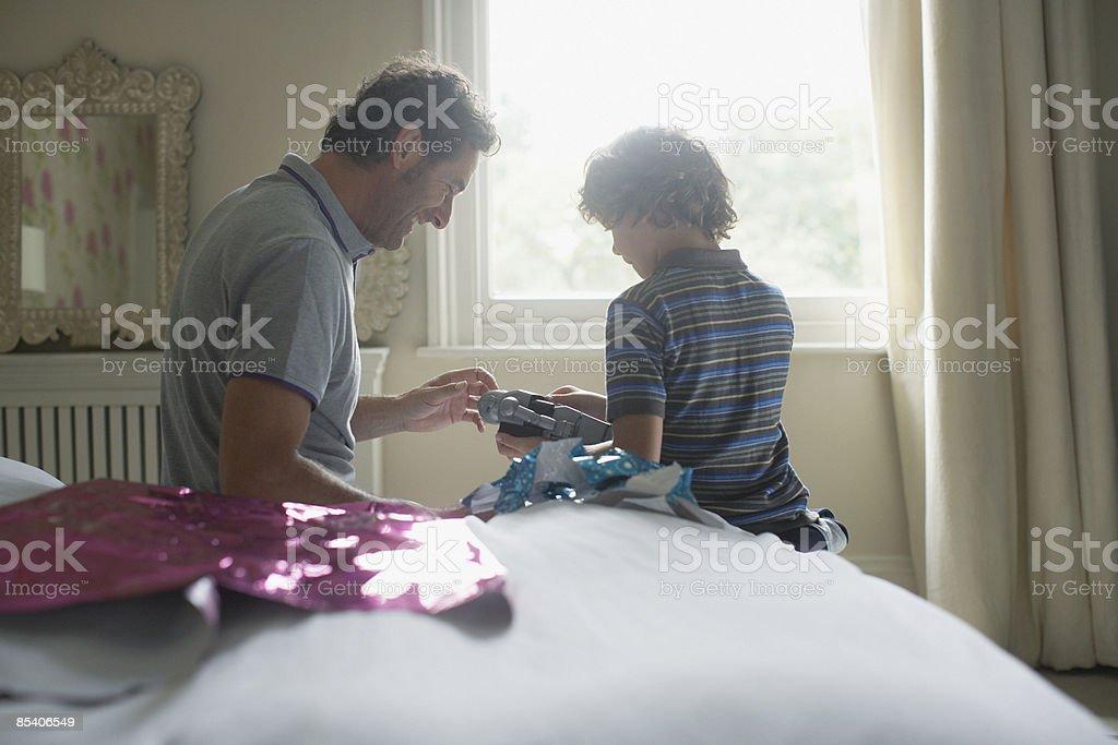 Father giving son Christmas gift stock photo