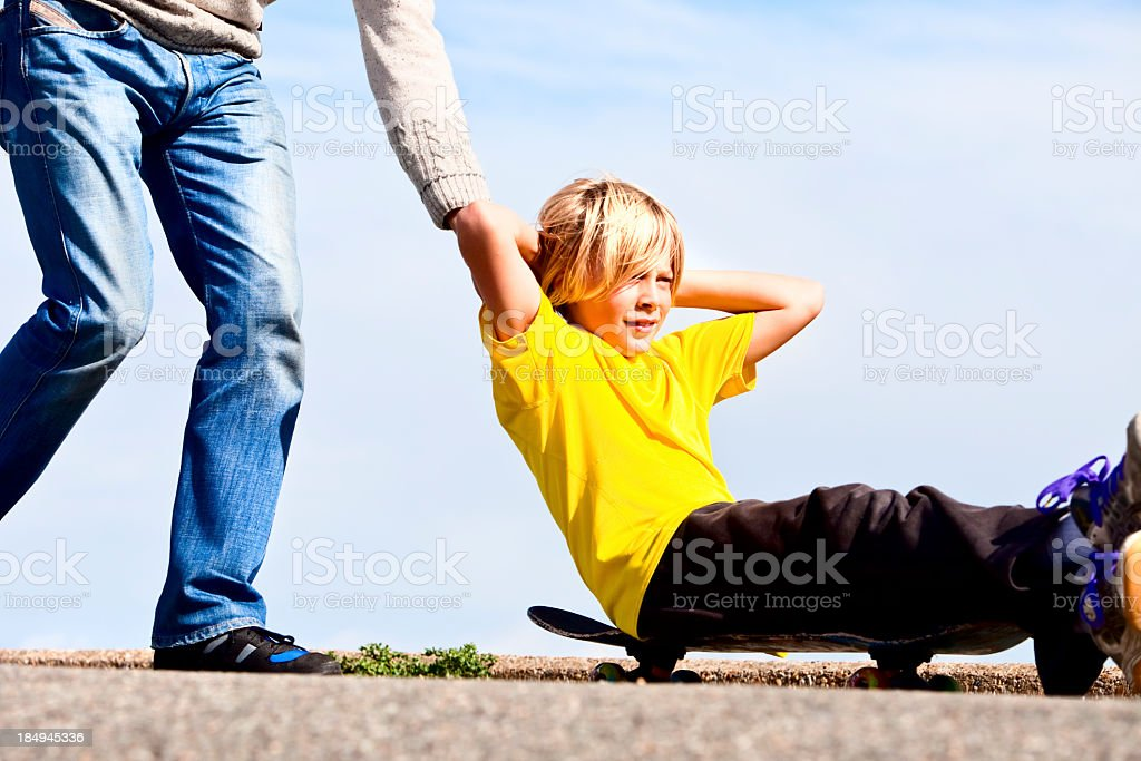 father guiding happy son along on his journey royalty-free stock photo