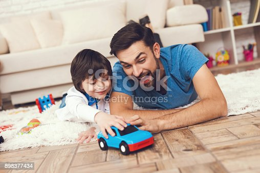 istock Father has fun with his son. An exemplary father and a boy at leisure. 898377434