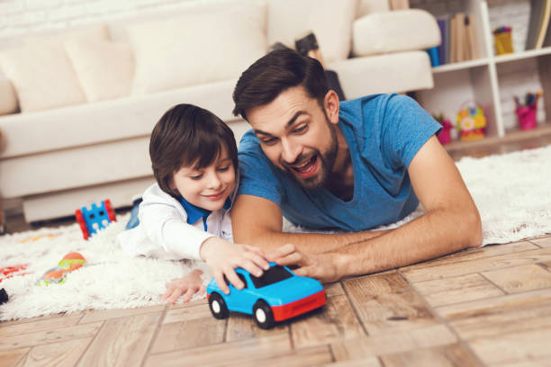 Father has fun with his son an exemplary father and a boy at leisure picture id898377434?b=1&k=6&m=898377434&s=612x612&w=0&h=omi12cgiv9mgysmbej5fz7mb10wexskgku479tf11fu=