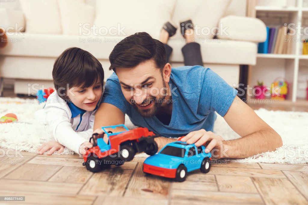 Father has fun with his son. An exemplary father and a boy at leisure. stock photo