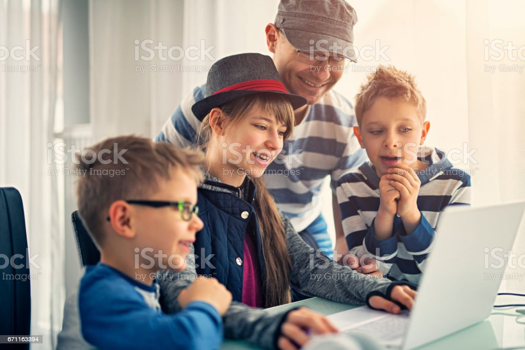 Father having fun coding with kids stock photo