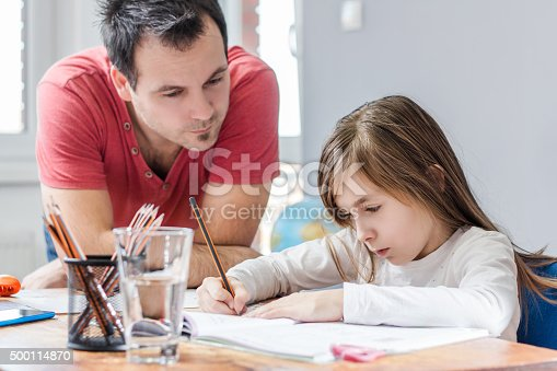 istock Father Helping Daughter With Homework 500114870