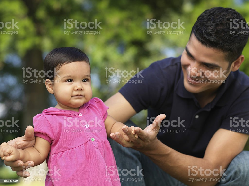 Father helping his daughter royalty-free stock photo