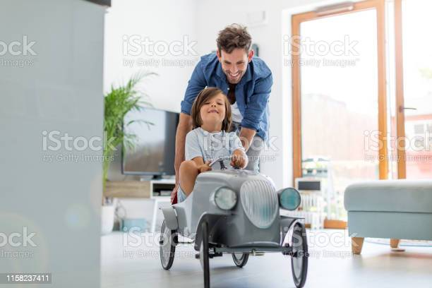 Father helping his son to drive a toy peddle car picture id1158237411?b=1&k=6&m=1158237411&s=612x612&h=6ap5lr3g42dou3n1bk ttoj5e0cndut1ji8l9wd2dgq=