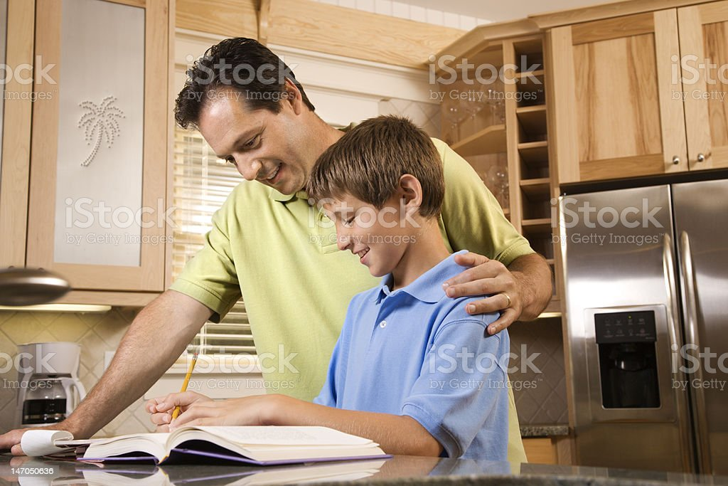 Father Helping Son with Homework royalty-free stock photo